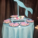 Teal Mermaid Table  $40.00 / Tablecloth Rental $3.00