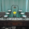 """Bird Chalkboard Stands (2) $5.00 each / Three Tier Black Wrought Iron Stand with Bowls/Plates (2) $10.00 each / Black Wrought Iron """"Welcome"""" Heart Stand (2) $4.00 each / Glass Dish $1.00"""