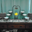 "Bird Chalkboard Stands (2) $5.00 each / Three Tier Black Wrought Iron Stand with Bowls/Plates (2) $10.00 each / Black Wrought Iron ""Welcome"" Heart Stand (2) $4.00 each / Glass Dish $1.00"