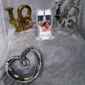 "Mr. & Mrs. picture stand 8 1/2"" x 4 1/2""    $1.00 Silver Heart 10"" x 8 1/2""     $1.00 Gold LOVE    8 1/2"" x 8      $1.00 Silver LOVE  8 1/2"" x 8""   $1.00"